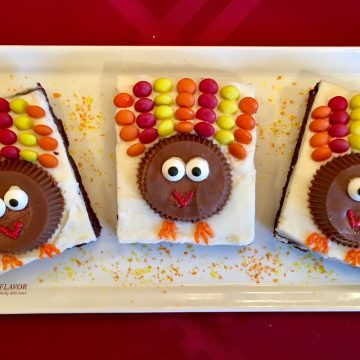 Turkey Brownies are an easy recipe for rich fudgy homemade brownies topped with a creamy vanilla buttercream and turkeys made of candy! So much fun to make and eat! Turkey Brownies are guaranteed to become a holiday tradition!#homemadebrownies #candyturkeys #turkeybrownies #dessert #easy recipe #funforkids #holiday #Thanksgiving #swirlsofflavor