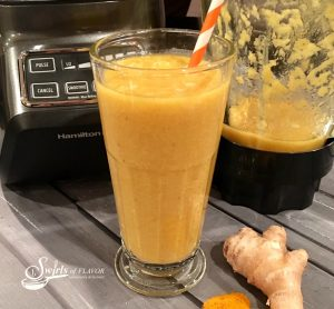 Turmeric Smoothie, golden in color, bursting with fresh fruit flavors and brimming with amazing health benefits is a great way to start your day!. turmeric | ginger | mango | banana | smoothie | healthy | breakfast | drink