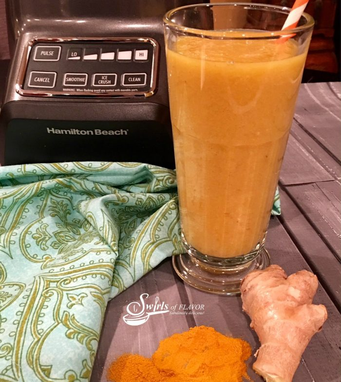 Turmeric Smoothie, golden in color, bursting with fresh fruit flavors and brimming with amazing health benefits, is a great way to start your day!. #turmeric |#mango #easyrecipe #banana #smoothie #healthyrecipe #breakfast #drink #swirlsofflavor