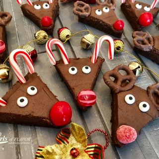 Reindeer Brownies is an easy recipe that will quickly become a holiday tradition and so much fun for kids! Fudgy homemade brownies topped with a silky-smooth cocoa buttercream frosting come to life as Rudolph with sugar eyes, candy cane antlers and a bright red candy nose, of course! #homemadebrownies #reindeer #holiday #Christmas #easyrecipe #Rudolphthe rednosedreindeer #funforkids #reindeerbrownies #candycane #swirlsofflavor