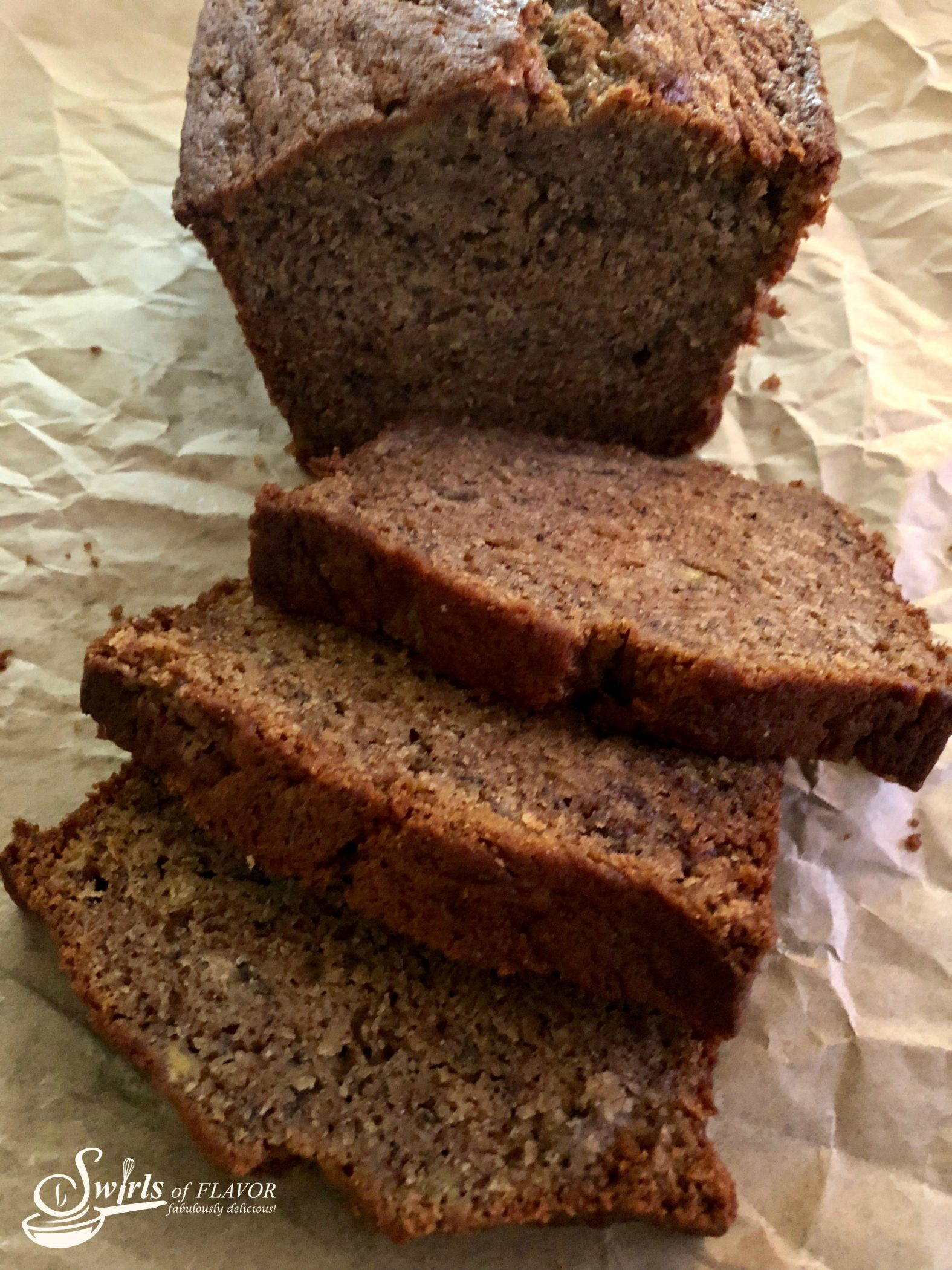 Best Ever Banana Bread with slices on parchment paper