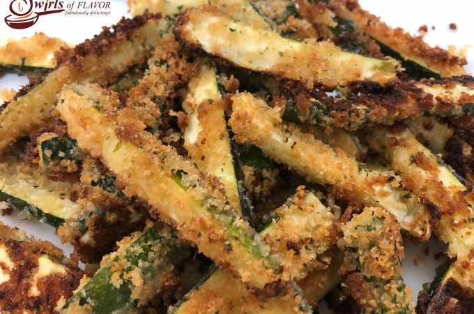 Baked Zucchini Fries, a healthy alternative to french fries, bake in the oven with a crispy parmesan panko coating that both kids and adults will love! Bet you can't eat just one! zucchini | fries | oven baked | healthy | snack | appetizer | side dish | vegetable | cheese | Parmesan | kid friendly