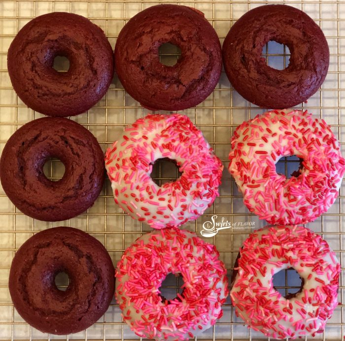 Love is in the air when you bake Red Velvet Donuts! Intense red color, cake-like texture and deep chocolate flavor make them perfect for Valentine's Day! easy dessert | baked donuts | red velvet | Valentine's Day | fun for kids