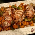 Sheet Pan Balsamic Chicken Thighs, Brussel Sprouts & Sweet Potatoes roast together in a balsamic honey sauce with just a hint of heat.