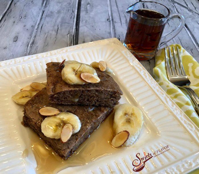 Sheet Pan Banana Bread Pancakes make mornings easier and oh so delicious! Brown sugar, cinnamon and bananas bake in a pancake batter in just minutes! sheet pan | breakfast | banana bread | easy | fun for kids