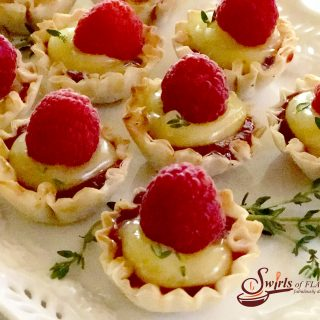 No-Bake Raspberry Lemon Thyme Tartlets are a 5 ingredient quick and easy dessert that's bursting with spring flavors and fruity sweetness! lemon | raspberry | thyme | fillo shells | mini dessert | no bake | no cooking | fresh herbs | easy recipe | #swirlsofflavor