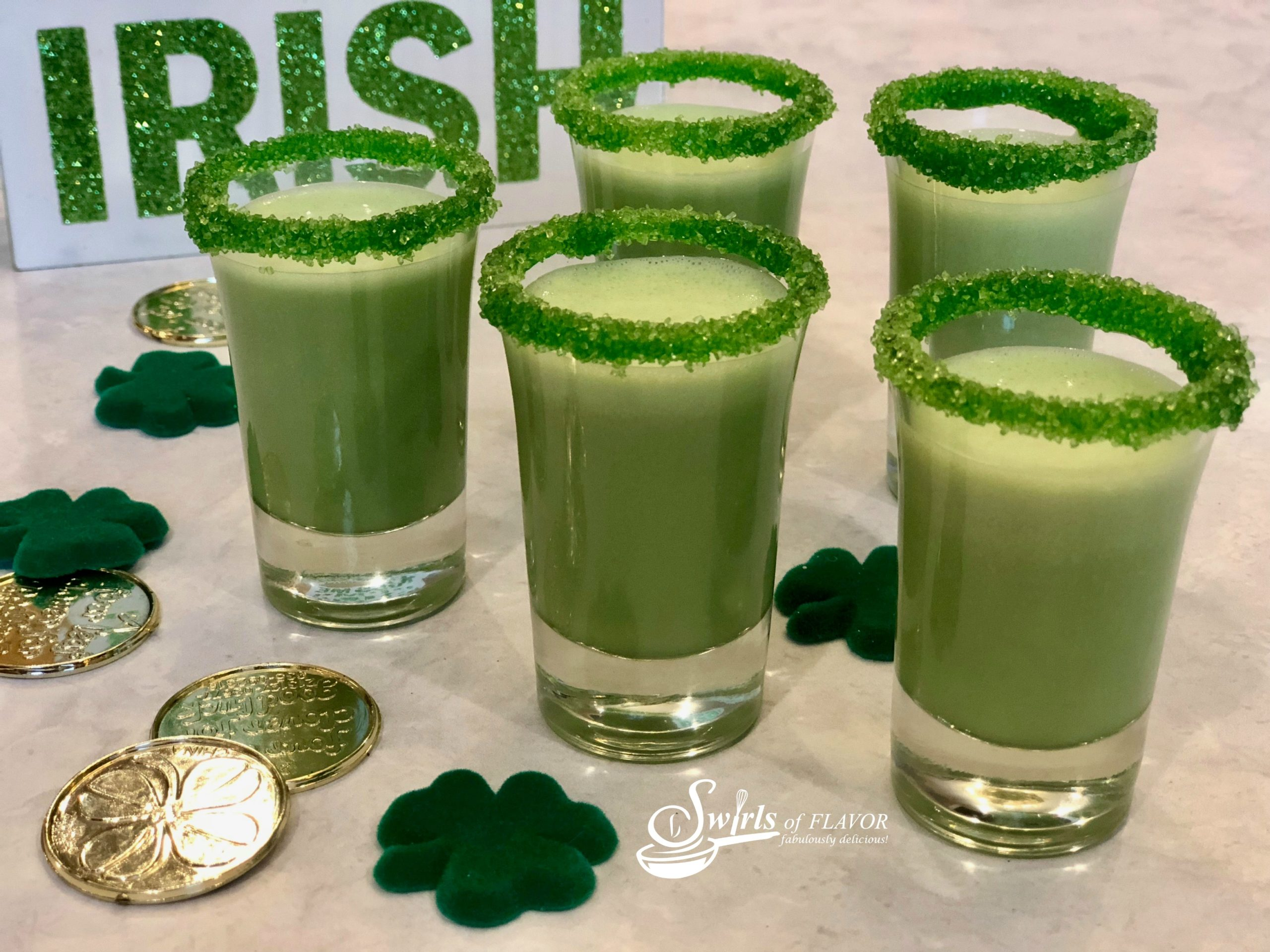Shamrock Shakes Recipe in five shot glasses with sugar rims