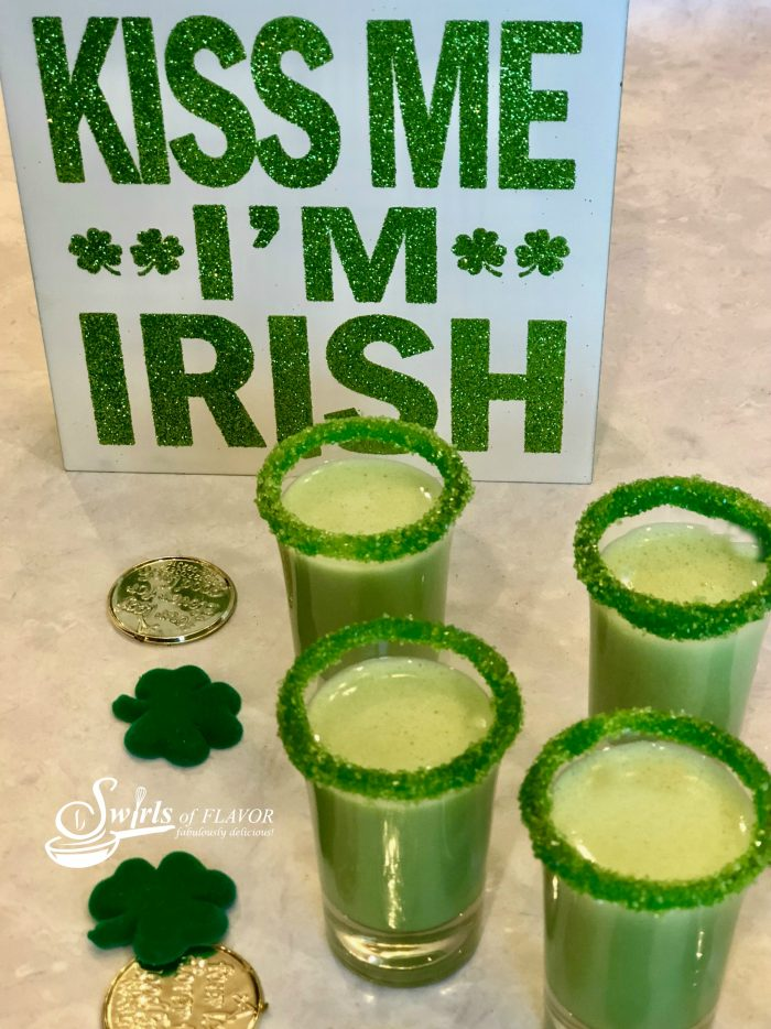 Shamrock Shake Shooters, made with vanilla ice cream, Irish Whiskey, mint flavoring and tinted green, are sure to be the hit of your Saint Patrick's Day!
