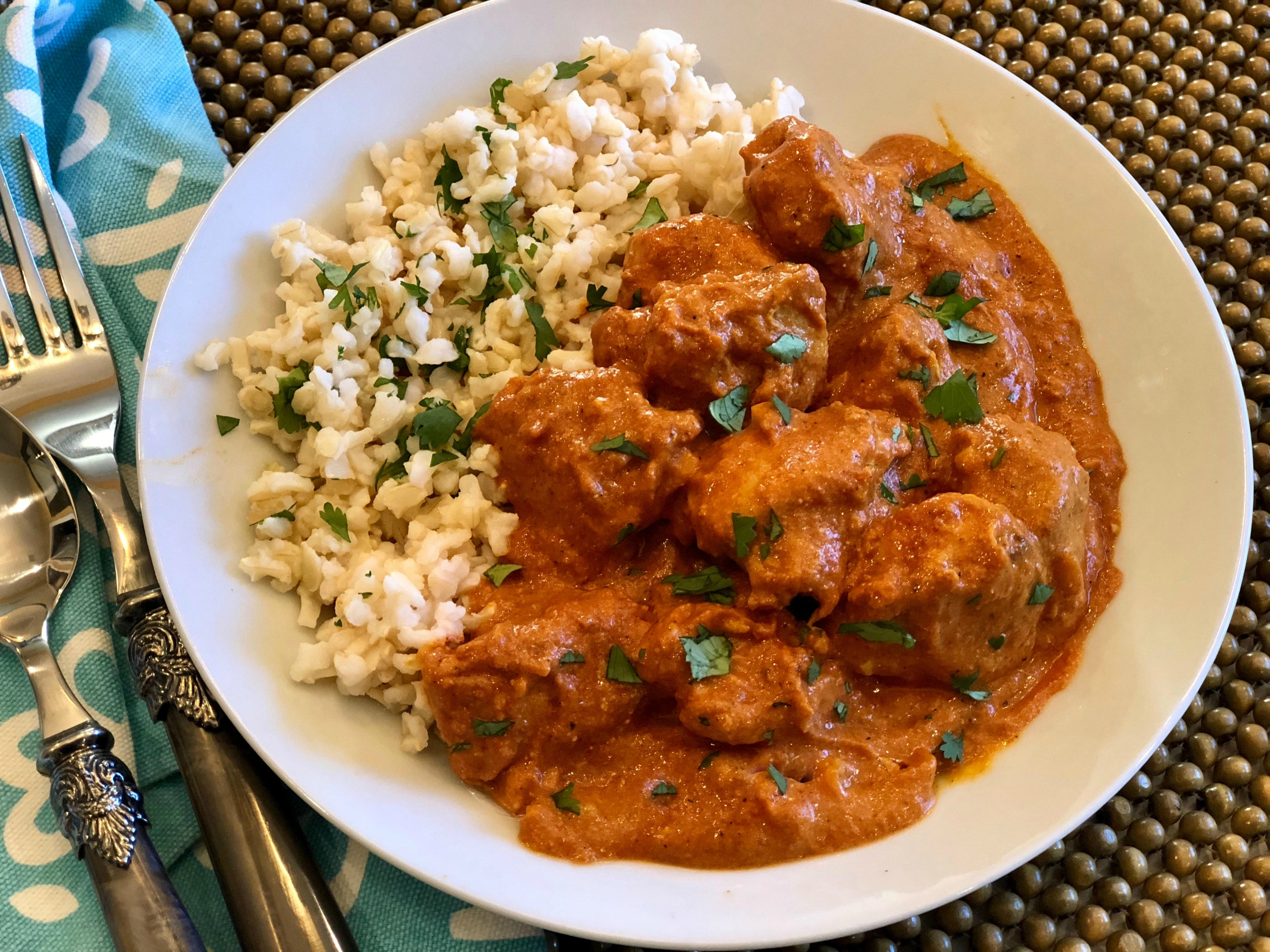 Indian Butter Chicken with rice in a bowl