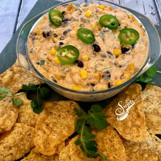 Creamy Corn and Black Bean Dip, an easy dip recipe that's bursting with cheesy goodness and a hint of spice, served with tortilla chips or fresh veggie dippers, is a delicious way to kick off your Cinco de Mayo fiesta! hot dip | corn | black bean | creamy dip | appetizer | party food | #swirlsofflavor