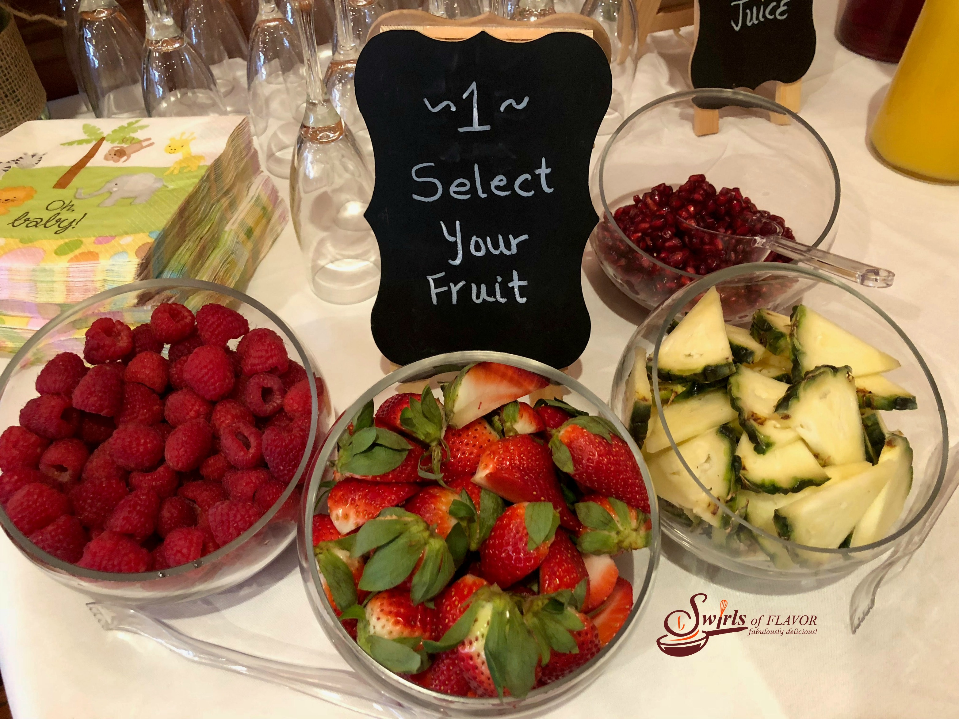Select your fruit sign with bowls of fresh fruits
