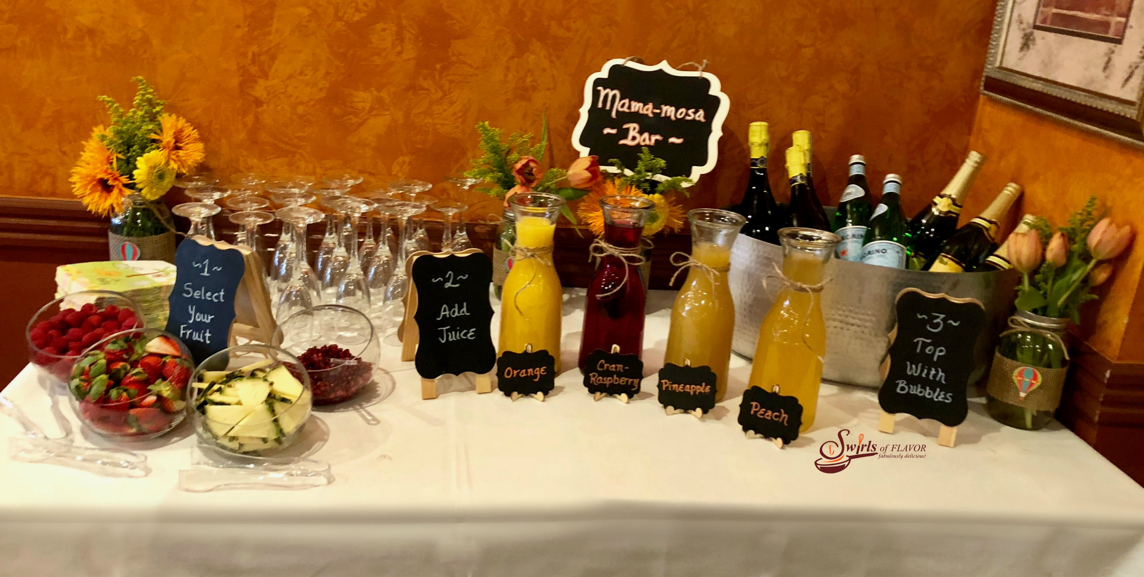 A Mimosa Bar with fresh fruit, juices and sparkling wine