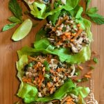 Thai Chicken Lettuce Wraps is an easy dinner recipe bursting with fresh ginger, garlic and Thai basil, that cooks on the stove top and is served in buttery lettuce leaves with a drizzle of fresh lime.