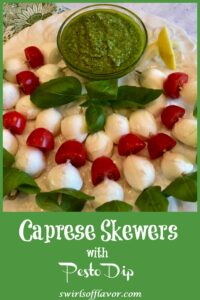 Skewers of mozzarella, tomato and basil with pesto