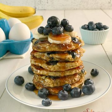 stack of gluten free blueberry pancake recipe with fresh blueberries and syrup