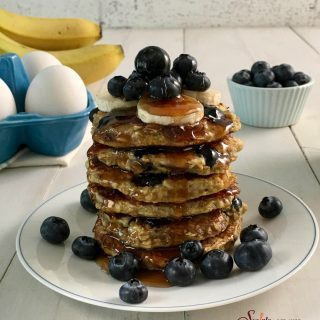With just four ingredients, you'll happily be making these from-scratch pancakes Gluten-Free Blueberry Pancakes over and over again for breakfast. easy | homemade | pancakes | gluten free | blueberry | banana | breakfast | brunch | #swirlsofflavor