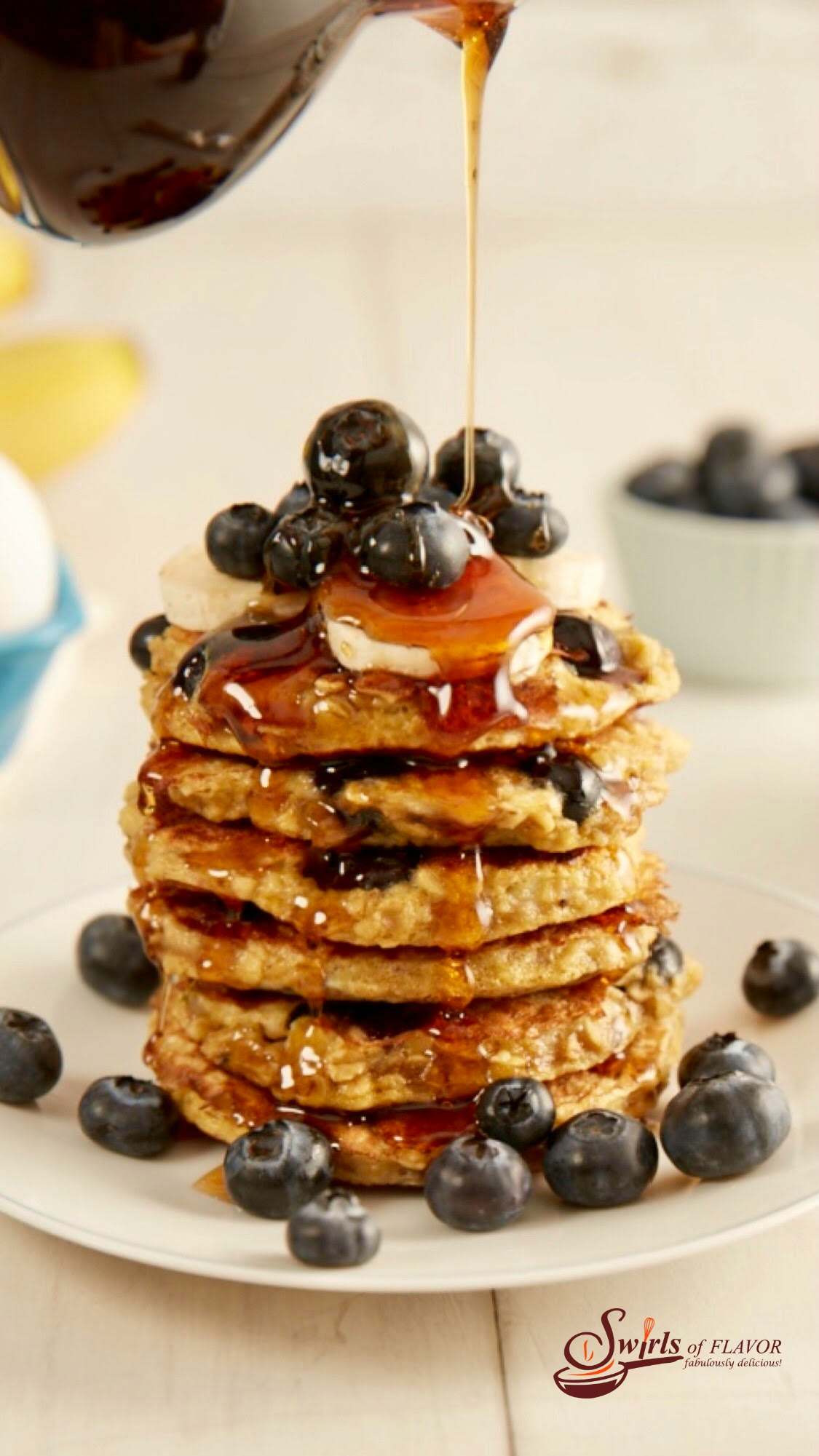stack of gluten free blueberry pancake recipe with syrup pouring over