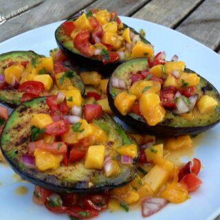 Grilled Avocados With Mango Salsa is an easy recipe for lightly seasoned avocados grilled to perfection and topped with a homemade lime-kissed mango salsa.