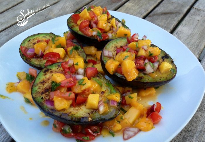 Enjoy Grilled Avocados With Mango Salsa when you're dining al fresco, lightly seasoned avocados grilled to perfection and topped with a homemade mango salsa.