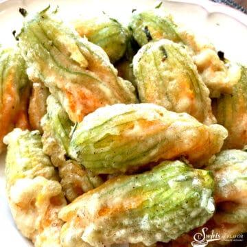 stuffed zucchini flowers in a dish