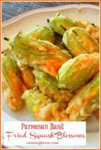 Cheese stuffed squash blossoms in a light fried batter on a round plate