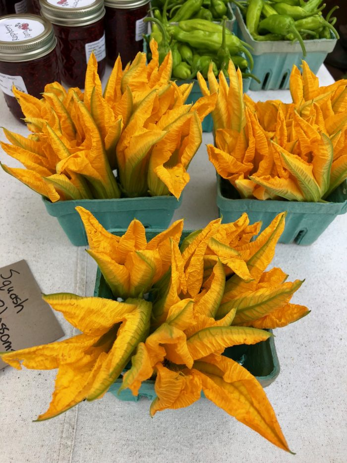 Squash blossoms for sale at farmers market
