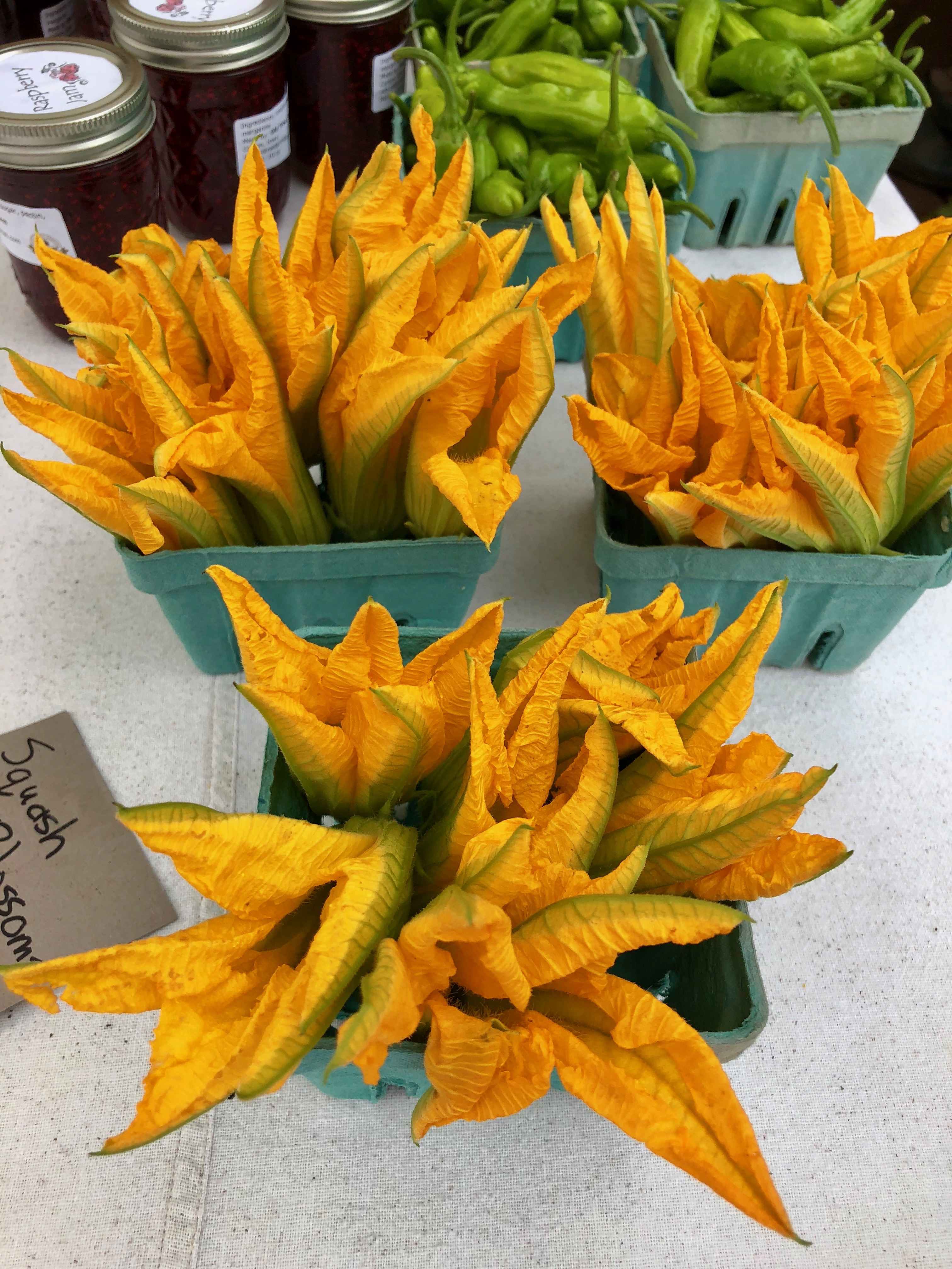 colorful Squash blossoms for sale at farmers market