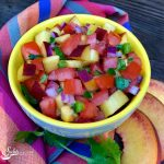 Jalapeno Peach Salsa is an easy summer recipe filled with sweet peaches, juicy tomatoes, a touch of jalapeno heat and zesty lime. Serve with tortilla chips, over grilled chicken, beef or seafood or with your favorite taco! #homemade #salsa #summer fruit #peaches #easy recipe #homemadesalsa #fruitsalsa #swirlsofflavor