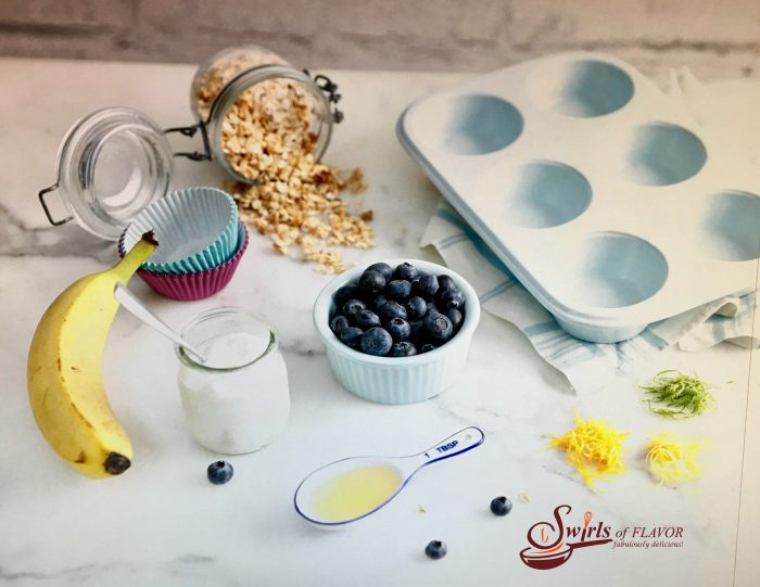 Made with fresh blueberries, yogurt and granola, Triple Citrus Blueberry Frozen Yogurt Cups are a refreshing and nutritious frozen snack, dessert or breakfast and the perfect way to cool off on a hot day. #blueberries #granola #Greekyogurt #frozendessert #snack #funforkids #kidfriendly #easyrecipe #summer #breakfast #brunch #swirlsofflavor