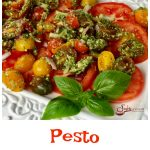 Pesto Tomato Salad combines garden fresh tomatoes, red onion and homemade pesto in an easy recipe that's bursting with fresh flavor and summertime goodness.