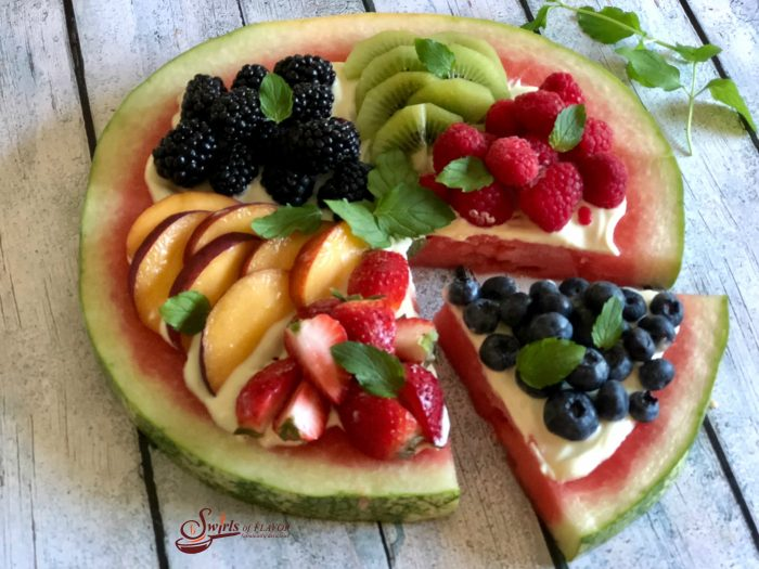 Watermelon Pizza is an easy dessert bursting with fresh summer fruits, mint and lime Greek yogurt! So much fun for kids and healthy too! #easydessert #berries #summerfruit #watermelon #fruitpizza #funforkids #swirlsofflavor