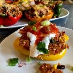 Mexican Quinoa Stuffed Peppers is an easy recipe that's perfect for a weeknight dinner and beautiful enough to serve to guests. Stuffed peppers take on a Mexican flair, bursting with a filling of quinoa, black beans, corn, tomatoes and salsa. #peppers #stuffedpeppers #quinoa #quinoastuffedpeppers #blackbeans #corn #easyrecipe #dinner #weeknightdinner #comfortfood #swirlsofflavor