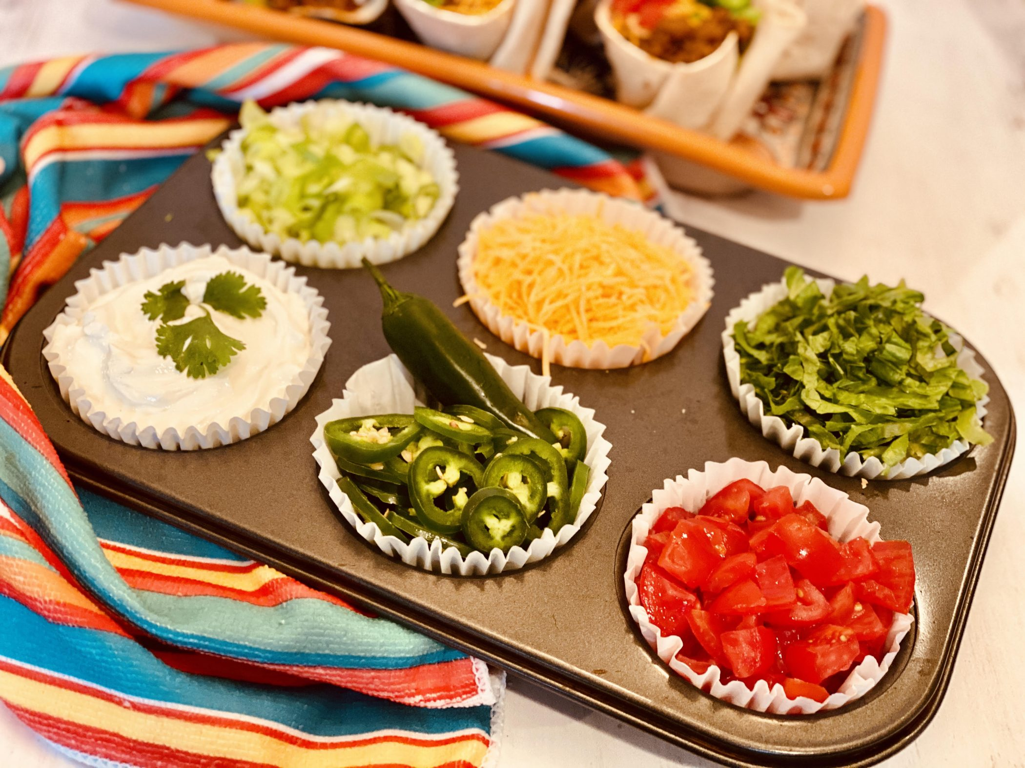 Taco toppings in a cupcake pan
