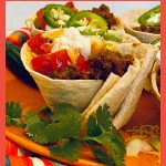 large beef taco cup with toppings and text overlay