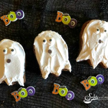 three ghost shaped brownies and sugar Boo decorations