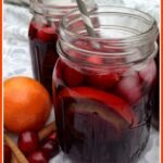 mson jars of cranberry sangria with straws and text overlay