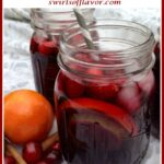winter sangria with cranberry juice and text overlay