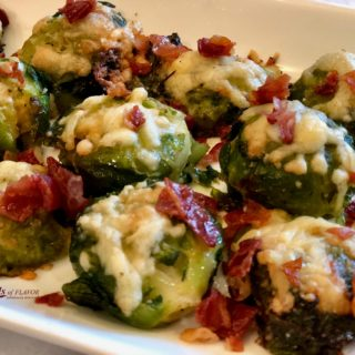 Smashed Brussels Sprouts With Crispy Prosciutto will be your new go-to side dish recipe for special occasions! Smashed sprouts are roasted with two cheeses and then topped with crispy prosciutto for the ultimate side dish! #brusselssprouts #smashedbrusselssprouts #roastedvegetables #prosciutto #holiday #entertaining #Thanksgiving #Christmas #easyrecipe #swirlsofflavor