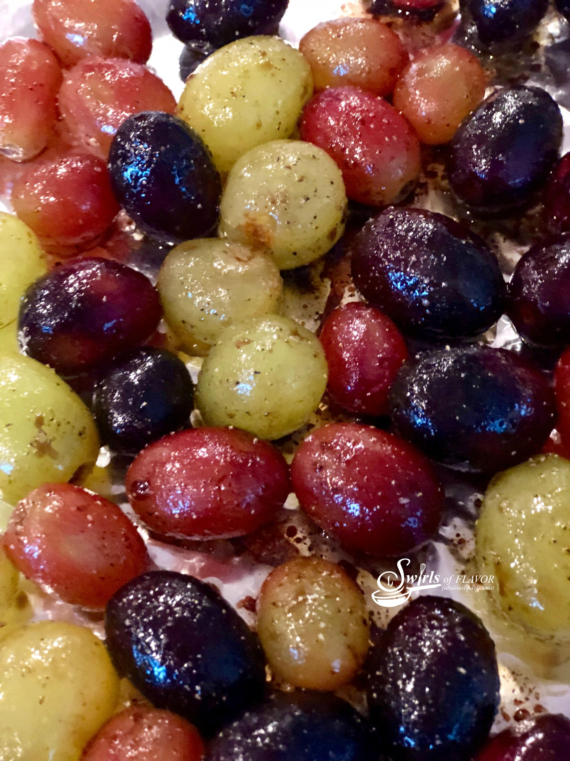 close up of roasted balsamic grapes in multi colors