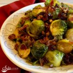 """Brussels Sprouts are the new """"it"""" vegetable and Brown Sugar Brussels Sprouts With Bacon And Cranberries will be your new go-to recipe. Brussels Sprouts, bacon and cranberries are coated in a sweet and tangy brown sugar glaze and roasted to perfection in just 25 minutes. An easy recipe for a vegetable side dish! #brusselssprouts #vegetable #sidedish #holiday #entertaining #Thanksgiving #Christmas #roastedvegetables #bacon #easyrecipe #glazedbrusselssprouts #swirlsofflavor"""