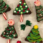 Christmas Tree Brownies is an easy homemade brownie recipe that's a merry holiday treat. Simply cut brownies into triangles and decorate with a homemade buttercream frosting, candy canes, candy, sprinkles and edible glitter! Make Christmas even more fun and festive with Christmas Tree Brownies! #brownies #homemade #baking #holiday #Christmas #funforkids #Christmastrees #candycanes #swirlsofflavor
