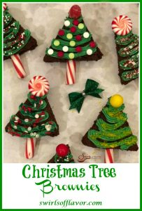 overhead picture of brownies made into Christmas trees with frosting and candy and text overlay