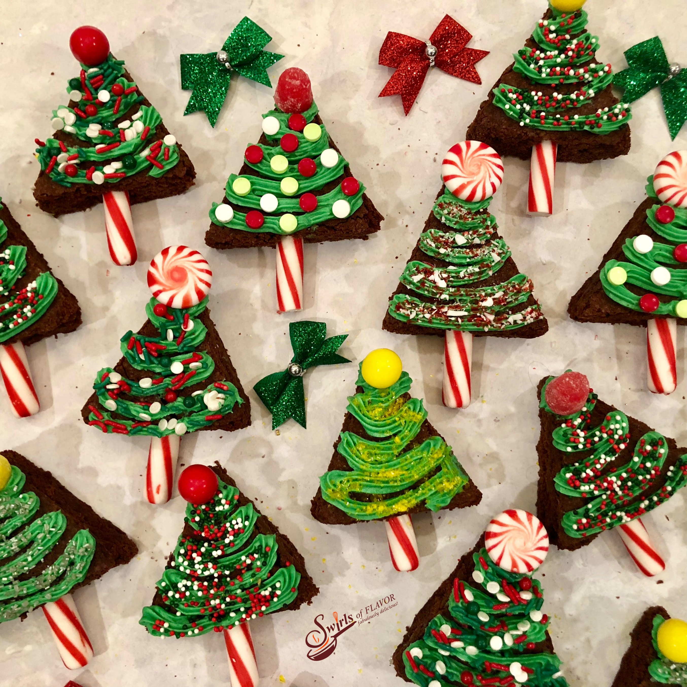 brownies shaped like Christmas trees and decorating with frosting and candy