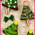 Four christmas tree brownies with bow and text overlay