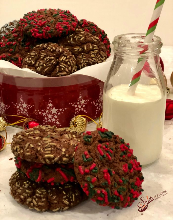 Double Chocolate Espresso Cookies combine the flavors of chocolate and coffee in a decadent cookie for the holiday season. When deep rich chocolate cookie dough is flavored with espresso, studded with mini chocolate chips and rolled in festive holiday sprinkles, every bite is an indulgence. An easy cookie recipe to add to your baking list, this is definitely the best holiday cookie recipe around! #cookies #chocolate #espresso #coffee #holiday #baking #easyrecipe #mochaccino #swirlsofflavor