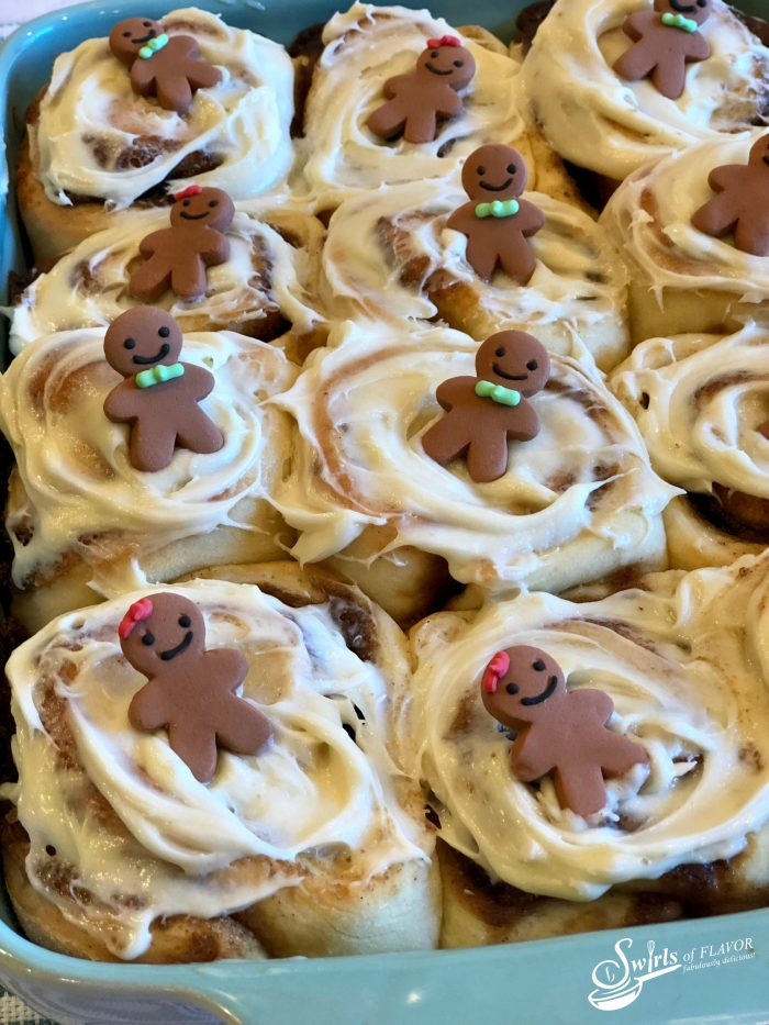 Christmas morning and Gingerbread Cinnamon Rolls go hand in hand. Gingerbread Cinnamon Rolls is an easy recipe filled with gingerbread spices and brown sugar and topped with a silky cream cheese glaze. #cinnamonrolls #cinnamonbuns #gingerbread #breakfast #brunch #Christmas #holiday #entertaining #easyrecipe #overnight #Makeahead #swirlsofflavor