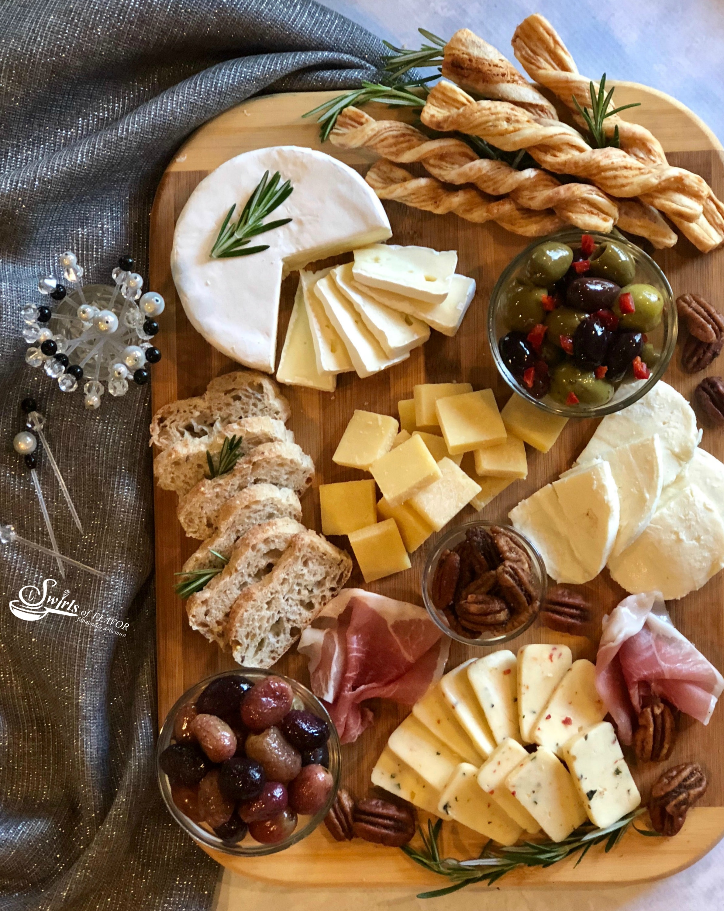 A Holiday Cheese Board with roasted grapes and spiced pecans