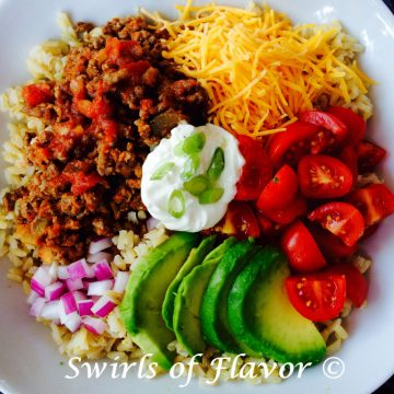 taco bowl with brown rice and taco toppings