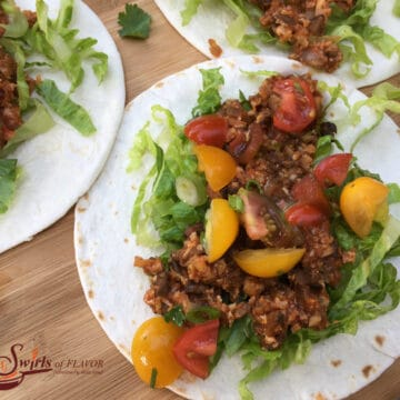 cauliflower tacos with shredded lettuce and tomatoes