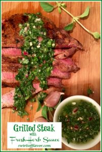 Grilled steak with a frresh herb sauce on a wooden board